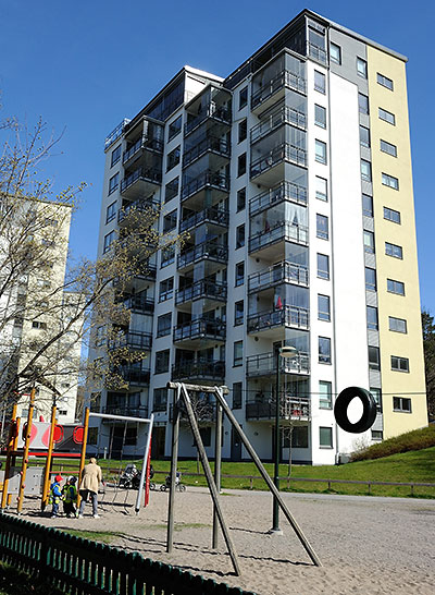 Playground and high rise near the Hägerstensåsen T-bana station in Stockholm, Sweden