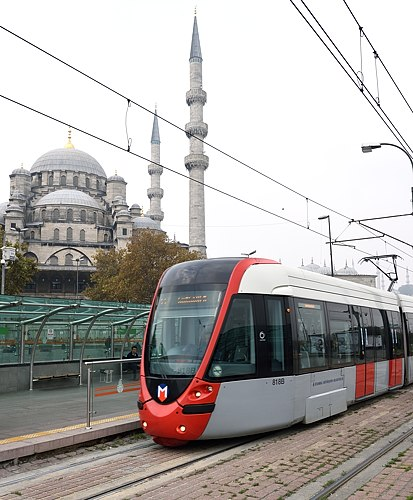 Tram at Eminönü station in Istanbul, with Yeni Cami in background