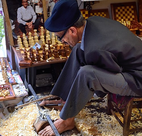 Wood carver in Marrakech Medina