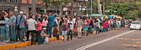 San Cristóbal food line | CC BY-NC 2.0 photo by DerMikelele